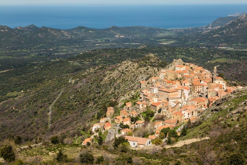 Village of Spelonato in Balagne region of Corsica. The mountain village of Speloncato in the Balagne region of north Corsica with maquis and the Mediterranean in royalty free stock photos
