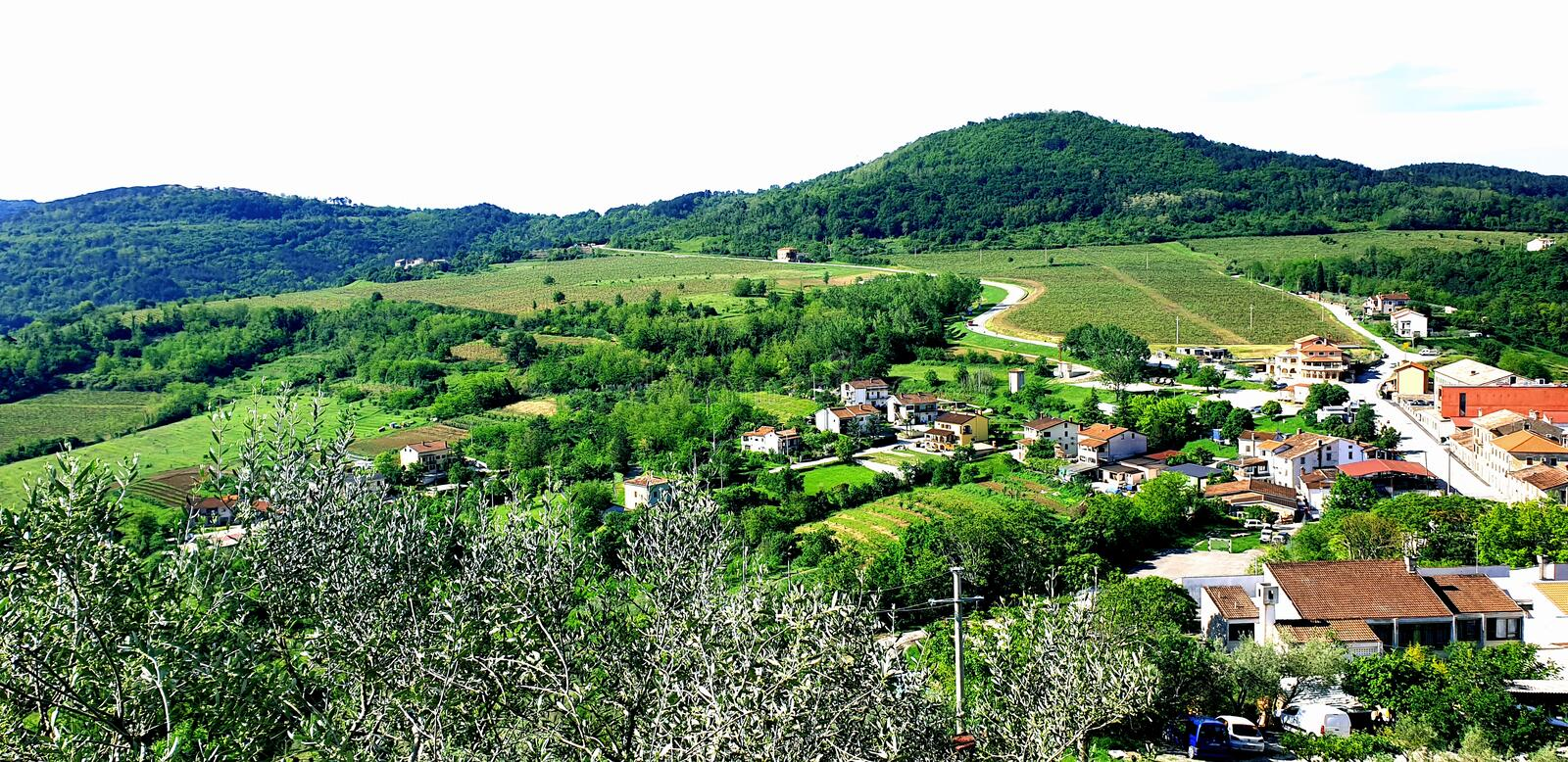 Village in spring time with hills and houses like in post cards. Croatian village fool of green fields and hills with small house royalty free stock photo