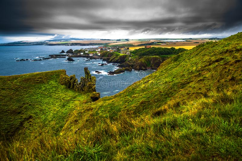 Village St. Abbs At The Spectacular Atlantic Coast of St. Abbs Head In Scotland.  stock photos
