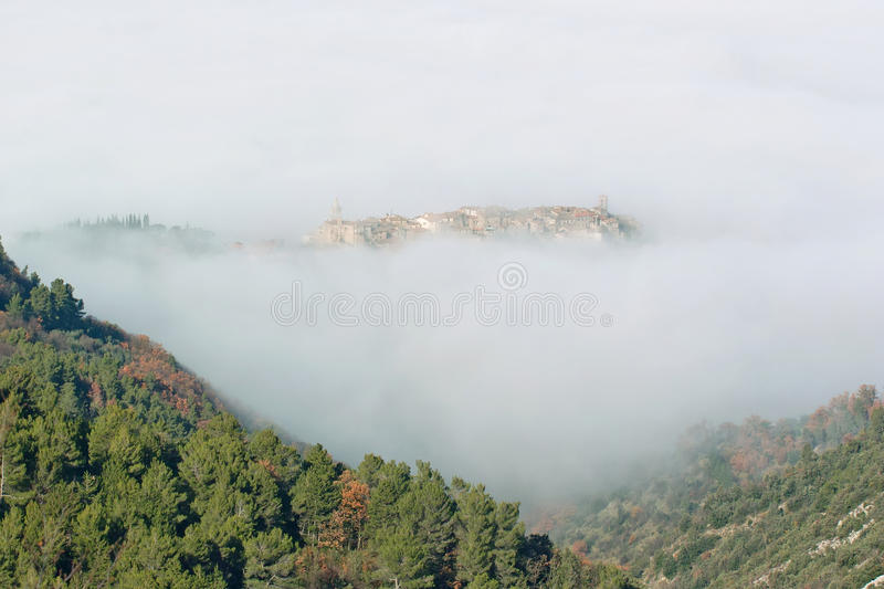 Download The Village Of Stroncone Shrouded In Fog Stock Photo - Image of country, atmospheric: 28712996