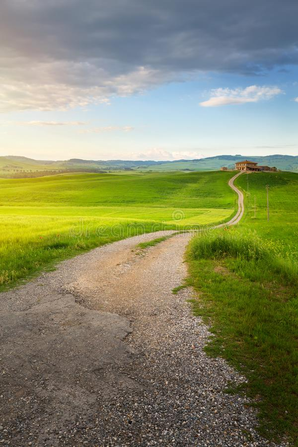 village in tuscany; Italy countryside landscape with Tuscany rolling hills ; sunset over the farm land and old country road stock image
