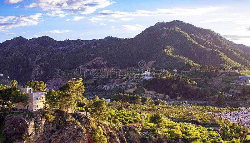 Village under the mountain against clear sky at sunset royalty free stock photo