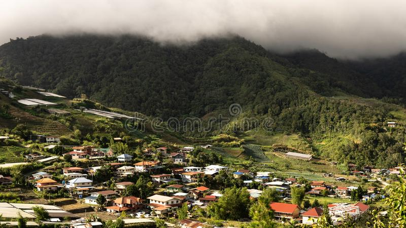 The villlage under the mountain with cloudy sky. Villlage under mountain cloudy sky stock images