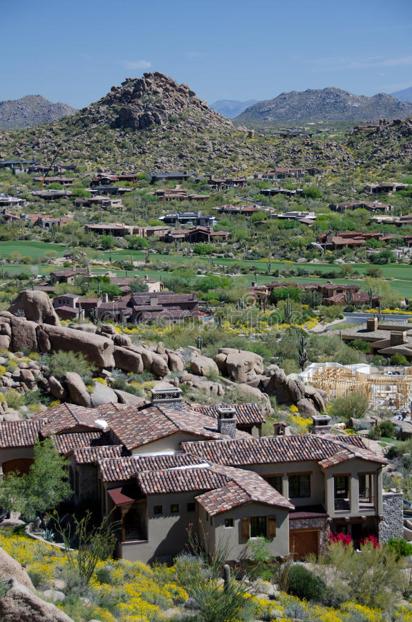 Village under Pinnacle Peak with McDowell Mountain range in the stock photography