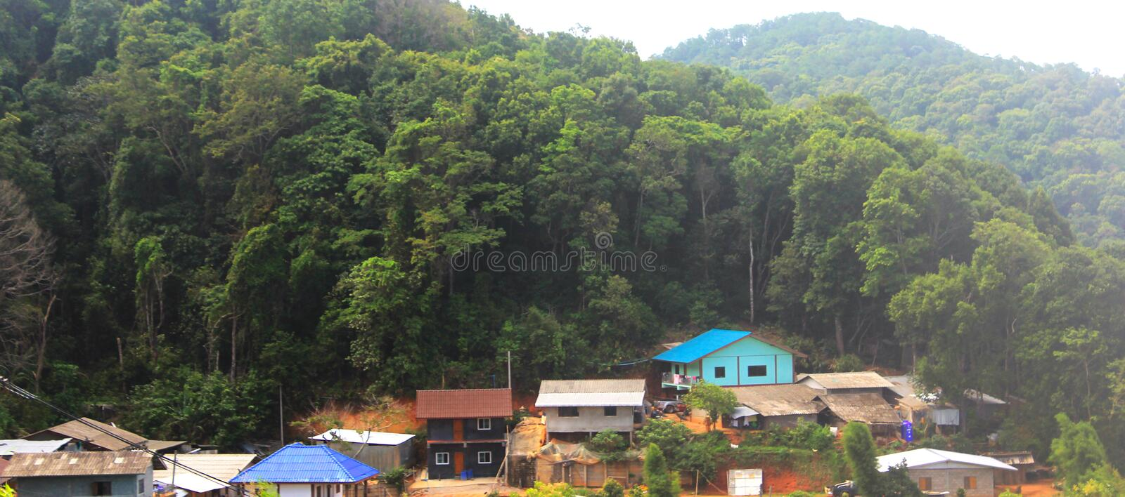 Village in the valley Beautiful views, beautiful traditional mountain huts and peaks in the bright morning light - image royalty free stock photo