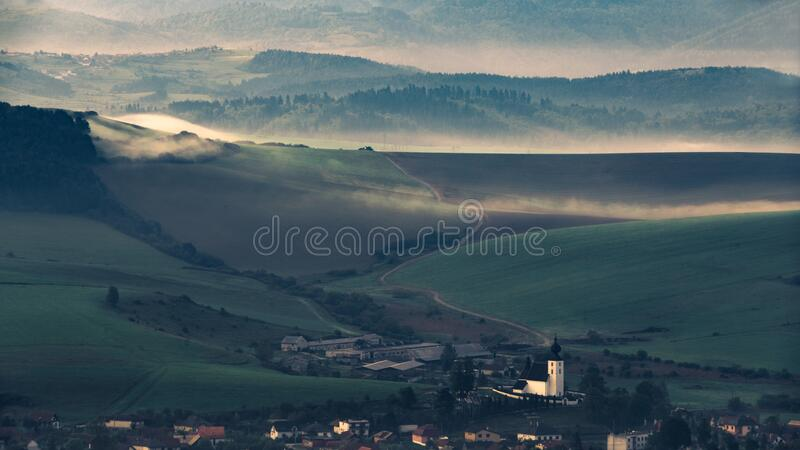 Village in valley at sunset royalty free stock images