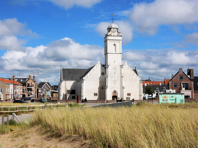 Village view with white church boulevard Katwijk aan Zee, royalty free stock image