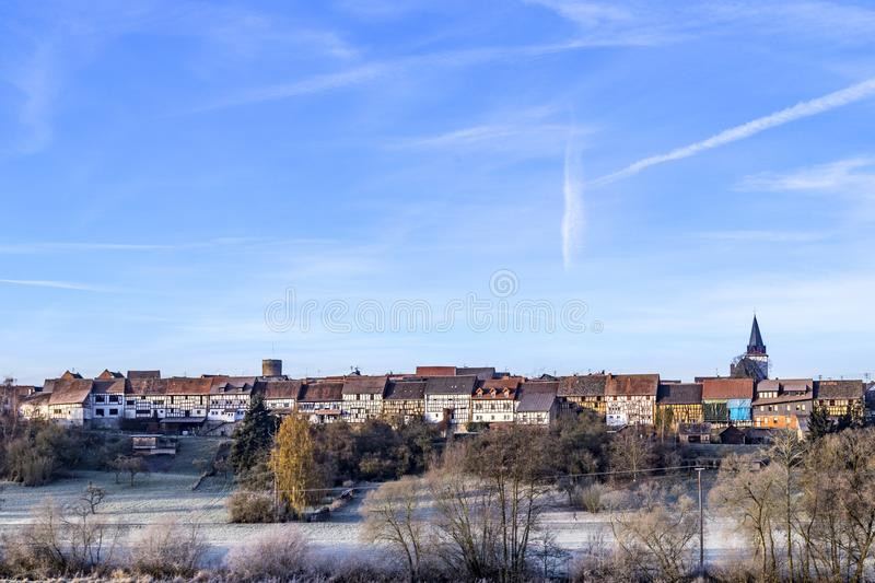 Village of Walsdorf, part of Idstein with famous old barn front. In sunrise stock photography