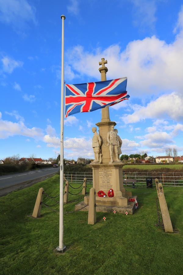 Village war memorial in England. The war memorial in the village of East Brent in Somerset, England on Remembrance Sunday 2017 stock photo