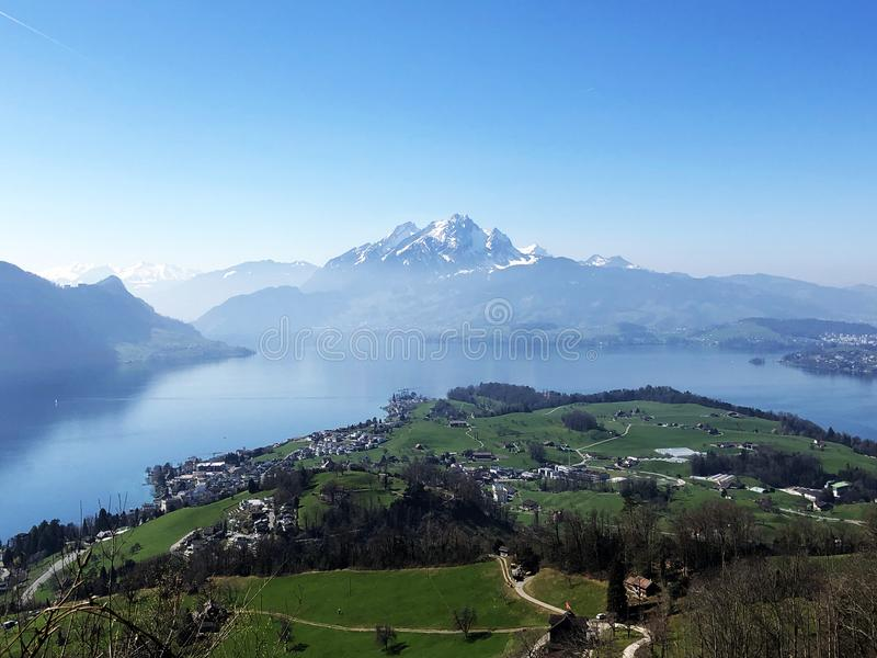 The village of Weggis on the shore of Lake Lucerne Vierwaldstätersee and the mountain Pilatus in the background royalty free stock images