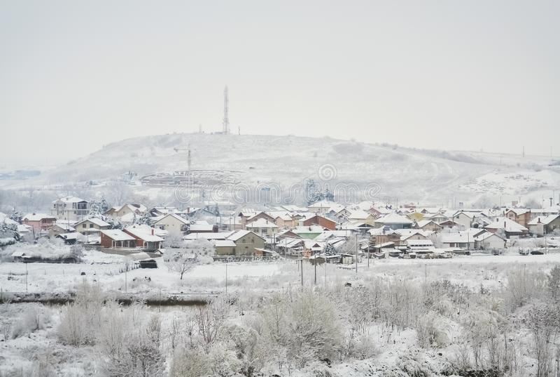 Village in winter stock photos