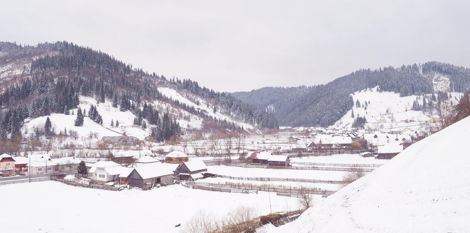 Village in winter time royalty free stock image