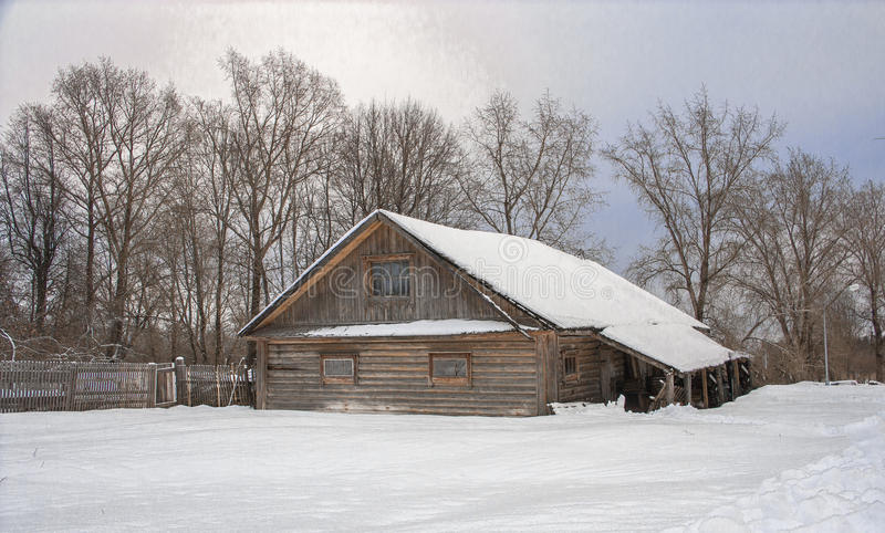 The village in winter. Wooden house in winter village royalty free stock image