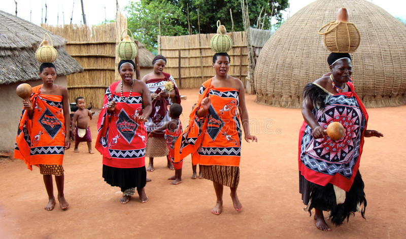 Village women. Strong character, sense of humour, this is what makes this Swaziland women unique. At right, chief of village stock images