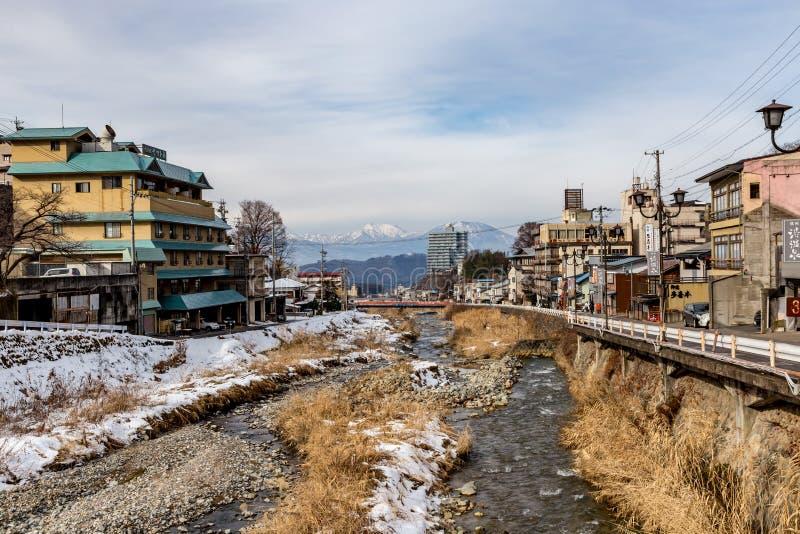 The Yoyoku River in Yamanouchi, Japan. The village of Yamanouchi with the Yokoyu River running through its center stock photography