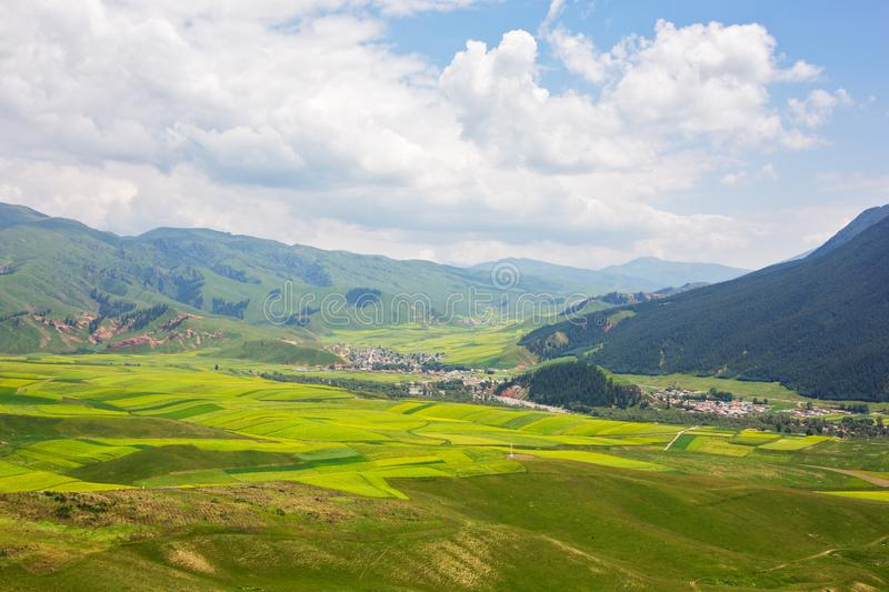 The villages in the valley. View from the Qilian Zhuo mountain stock photography