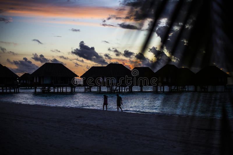 Download Villas With Silhouetted Honeymooners, Maldives Stock Photo - Image of destination, honeymooners: 75986122