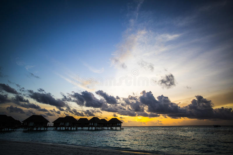 Download Villas at sunset, Maldives stock image. Image of silhouetted - 75984719