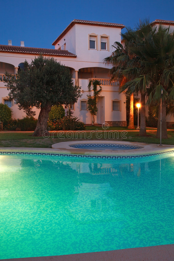 Villas with swimming pool stock photography
