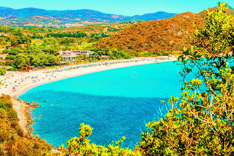 Villasimius Beach on Mediterranean Sea on Sardinia Island in Italy. Shore of Beautiful Villasimius Beach at the Bay of the Blue Waters on the Mediterranean Sea royalty free stock photography