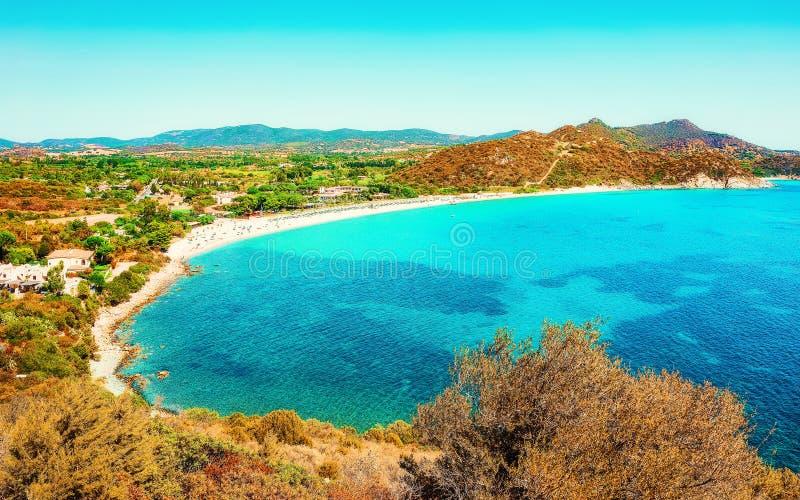 Villasimius Beach at Mediterranean Sea in Sardinia Island Italy. Shore of Beautiful Villasimius Beach at the Bay of the Blue Waters in the Mediterranean Sea on stock image
