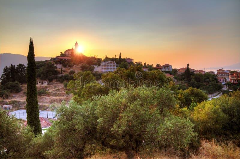 Ville de colline de coucher du soleil photographie stock