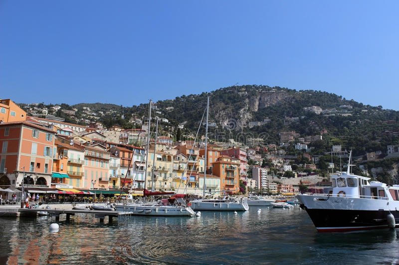 Villefranche Harbor. Villefranche, France - June 9, 2014 - Hoards of tourists arrive in the small town of Villefranche. The local economy largely depends on the royalty free stock images