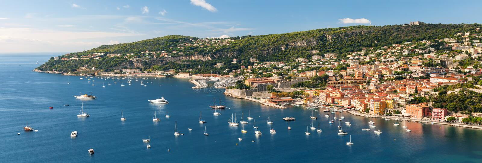 Villefranche-sur-Mer and Cap de Nice on French Riviera. Panoramic aerial view of French Riviera coast at Villefranche-sur-Mer harbour and Cap de Nice with royalty free stock photo