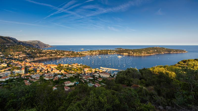 Villefranche-sur-Mer and Saint-Jean-Cap-Ferrat in Summer at sunset. French Riviera, Provence-Alpes-Cote-d`Azur, France. Villefranche-sur-Mer, Saint-Jean-Cap stock image