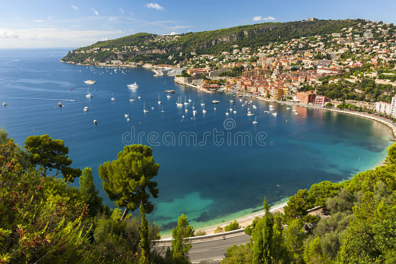 Villefranche-sur-Mer view on French Riviera. Aerial view of scenic French Riviera mediterranean coast with medieval coastal town Villefranche-sur-Mer, leisure stock images