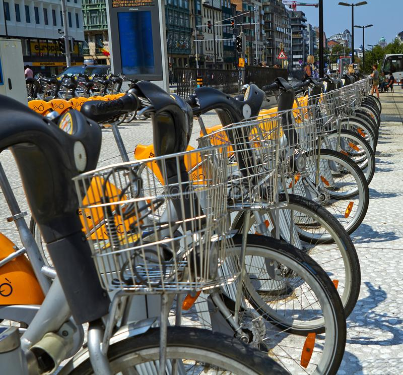 Villo bicycles parked in the bicycle sharing station on street. Public transportation in Brussels stock images