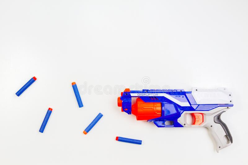 Vilnius, Lithuaania - March 5, 2019: Nerf N-Strike Elite Disruptor Blaster and Refill Bullet Darts on white background.  stock photography