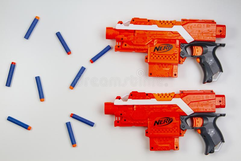 Vilnius, Lithuaania - March 5, 2019: Nerf N-Strike Elite Stryfe Blaster and Refill Bullet Darts on white background. Top view royalty free stock images