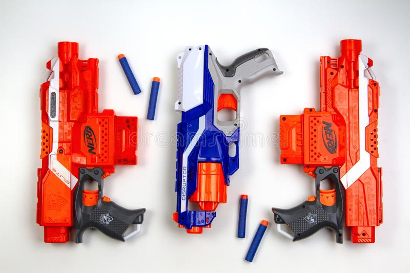Vilnius, Lithuaania - March 5, 2019: Nerf N-Strike Elite Stryfe Blasters and Nerf N-Strike Elite Disruptor Blaster with. Refill Bullet Darts on white background stock photography