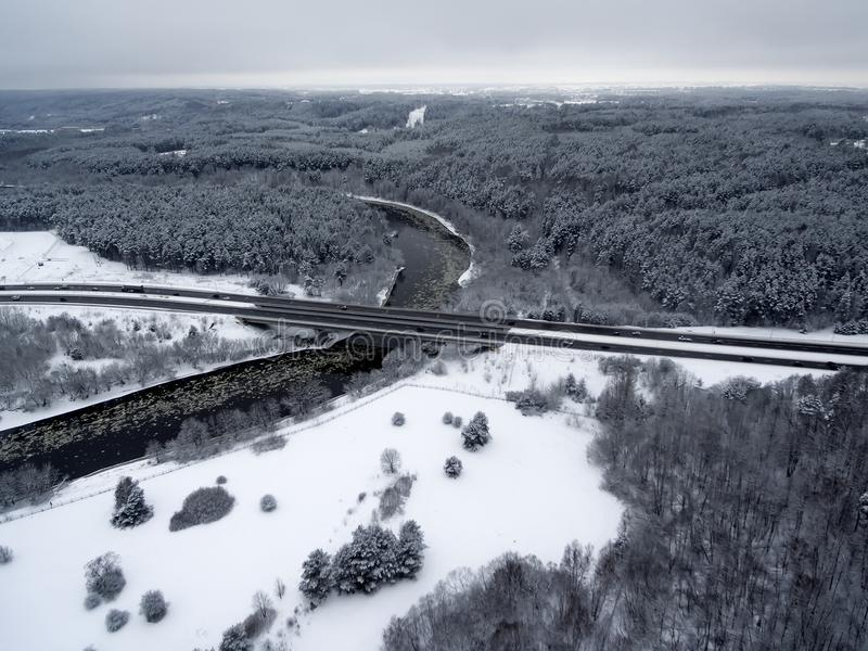 Vilnius, Lithuania: aerial top view of Neris river, surrounding forests and Gariunai road. In winter stock photos