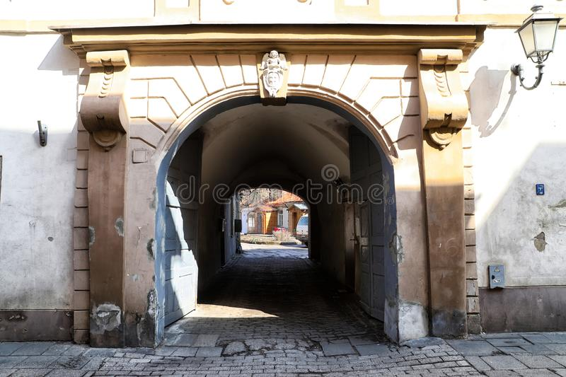 View of the old courtyard from the dark corridor stock photography