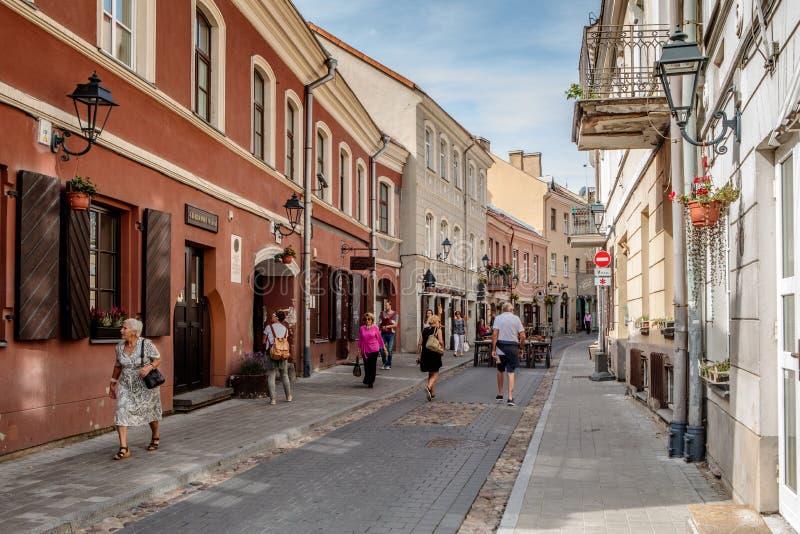 People walk along Saviciaus street. Vilnius, Lithuania - August 19, 2018: People walk along Saviciaus street, picturesque street of Vilnius old town stock image