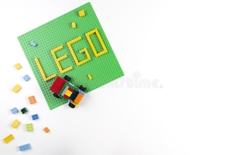 Vilnius, Lithuania - 17 August, 2019: Word LEGO on green baseplate and colorful Lego blocks on white background royalty free stock photos