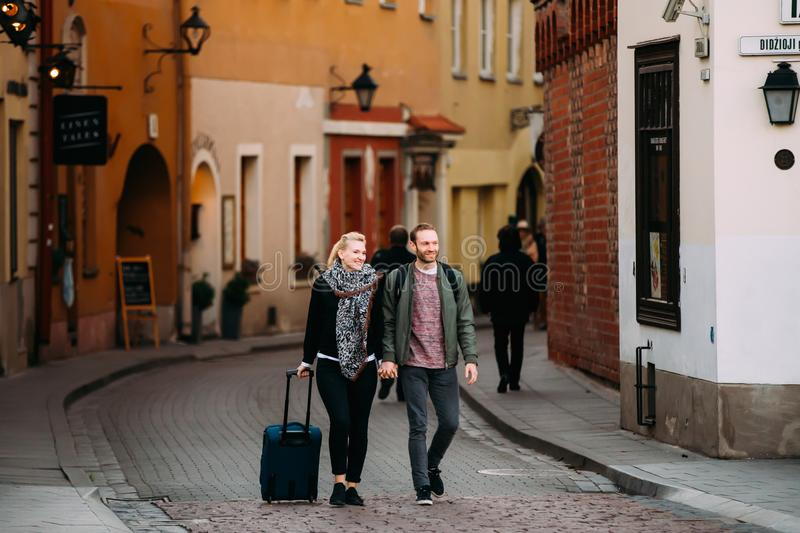 Vilnius, Lithuania. Couple Of Young Adult Man And Woman People Walking stock images