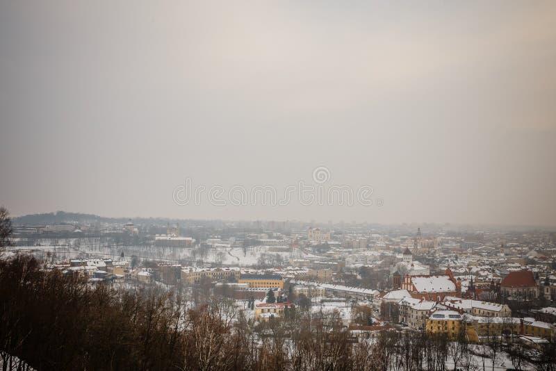 Vilnius / Lithuania - December 8, 2013: Winter morning snow Vilnius, Gediminas Tower with views of the river Neris and promenade stock image