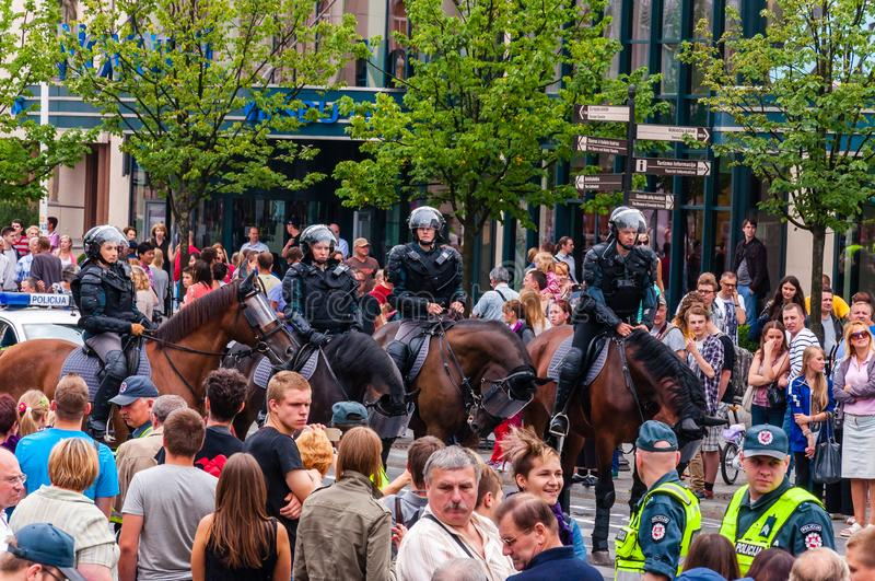 Armed mounted police forces riding at the end of Pride parade on Gedimino street. Event celebrating lesbian, gay, bisexual, royalty free stock photo