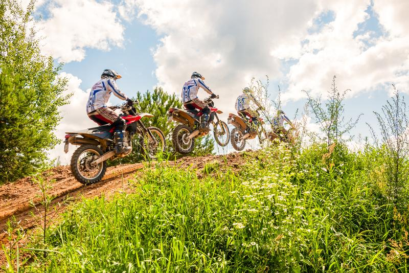 A group of amateur motorcyclists practice their manoeuvres. This is a multiple exposure shot taken on public land stock photos