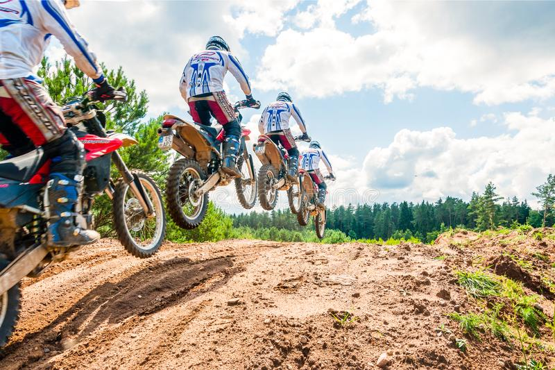 A group of amateur motorcyclists practice their manoeuvres. This is a multiple exposure shot taken on public land stock photography