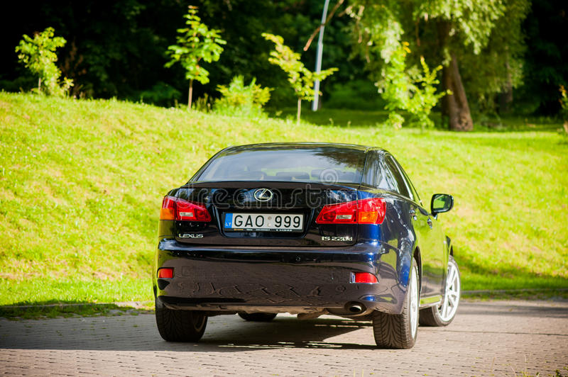 VILNIUS, LITHUANIA - JULY 10, 2012: Luxury Lexus Car. Green Grass and Park in background. Daytime. Sunlight. Luxury Lexus Car. Green Grass and Park in stock image