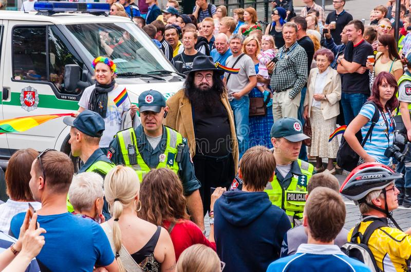 Police forces ensuring safety during the Pride parade on Gedimino street full of people. Event celebrating lesbian, gay, bisexual royalty free stock images