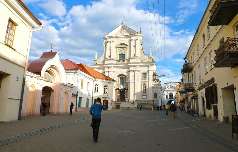 VILNIUS, LITHUANIA - JUNE 7, 2018: catholic church of St. Theresa in Didzioji street in the historic part of the old city stock photography