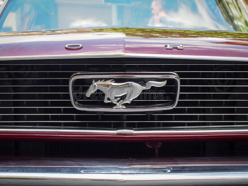 Real Ford Mustang first Generation horse logo. VILNIUS, LITHUANIA-JUNE 10, 2017: Real Ford Mustang first Generation horse logo on the radiator grill stock image