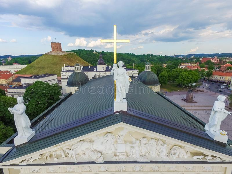 VILNIUS, LITHUANIA - JUNE 03, 2016: Vilnius Cathedral and Roof of it with Three Statues Saint Casimir, Saint Stanislaus, Saint He stock photos