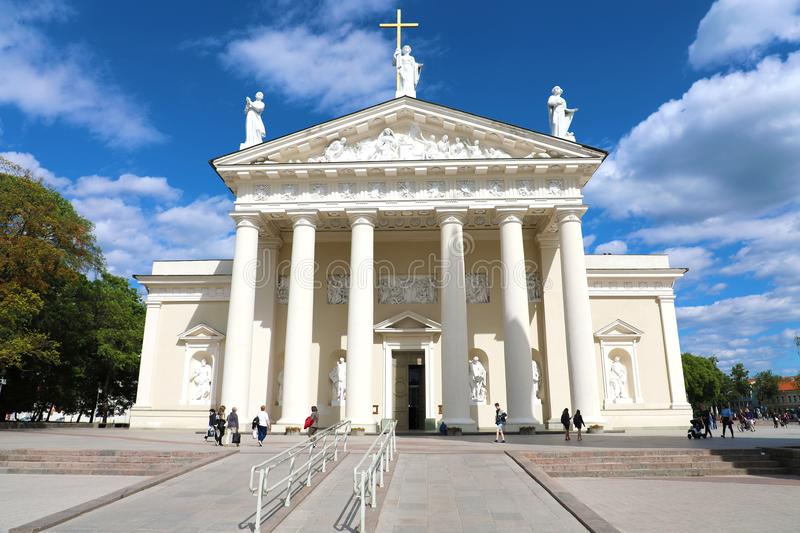 VILNIUS, LITHUANIA - JUNE 7, 2018: Vilnius Cathedral with white clouds in the blue sky and tourists in the square, Lithuania. VILNIUS, LITHUANIA - JUNE 7, 2018 royalty free stock image