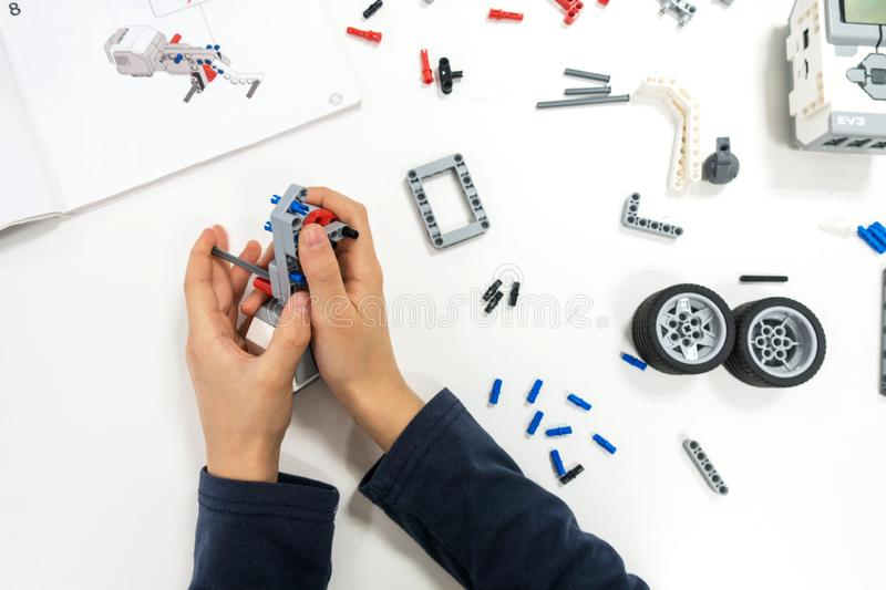 Vilnius, Lithuania - November 16, 2018: Kid making Lego robot mindstorms. Robotic, learning, technology, stem education royalty free stock photo